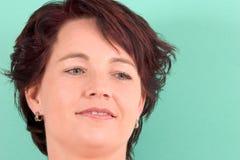 Brunette on green Stock Photo