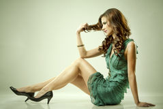Brunette and green dress Stock Image