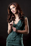 Brunette and green dress Royalty Free Stock Images