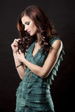 Brunette and green dress Royalty Free Stock Photos