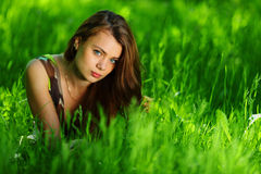 Brunette on green grass royalty free stock photos