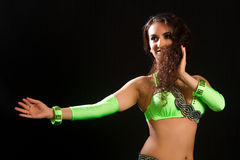 Brunette in a green suit oriental dance Royalty Free Stock Photos