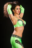 Brunette in a green suit oriental dance Royalty Free Stock Photography