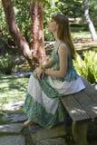 Brunette_in_green-white_dress-2 Stockbild