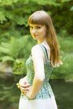 Brunette_in_green-white_dress_20 stock afbeelding