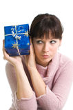 Brunette guessing what is in the present Stock Images