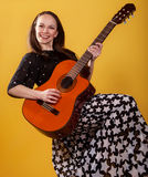 Brunette guitar player woman Royalty Free Stock Images