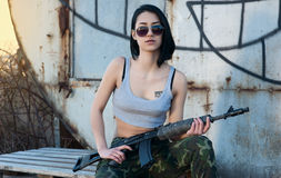 Brunette with gun Royalty Free Stock Image