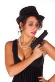 Brunette with gun and black hat II. Brunette with gun and black hat isolated in white background stock image