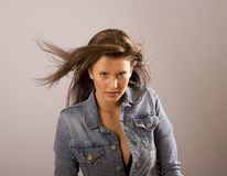 Brunette with Hair Blowing and Jacket Open royalty free stock images