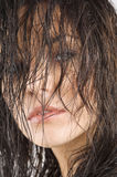 Brunette with hair on face Royalty Free Stock Images