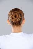 Brunette hair in a neat bun Royalty Free Stock Photography