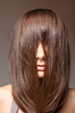 Brunette hair over face. Attractive young teen or girl with hair over face Royalty Free Stock Images