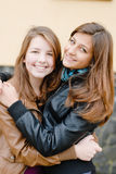 Brunette haired girls friends laughing Royalty Free Stock Images