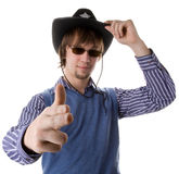 Brunette haired man in cowboy hat Stock Images