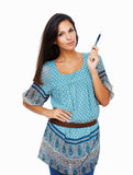 Brunette with hand on hip pointing pen upwards Stock Images