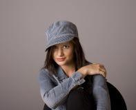 Brunette Hand on Shoulder in Denim Jacket and Cap Royalty Free Stock Photo