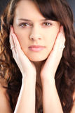 Brunette with Hands on Face Royalty Free Stock Images