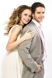 Brunette handsome man and his alluring woman Stock Images
