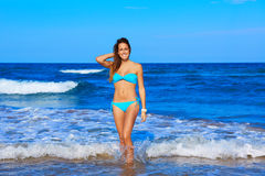 Brunette happy girl walking in the beach shore Royalty Free Stock Photos
