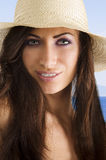 Brunette with hat Royalty Free Stock Image