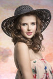Brunette with hat Stock Images