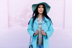 Brunette in hat and coat Royalty Free Stock Images