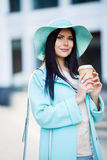 Brunette in hat with coffee Royalty Free Stock Photography
