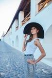 Brunette in hat with large fields. Brunette in a hat with large fields Stock Images
