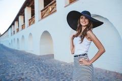 Brunette in hat with large fields. Brunette in a hat with large fields Stock Image