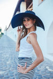Brunette in hat with large fields Royalty Free Stock Images