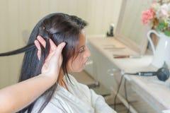 Brunette having hair re-styled Royalty Free Stock Photos