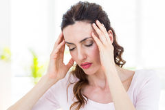 Brunette having headache Stock Photography
