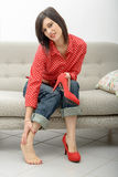 Brunette having pain in feet after wearing high-heeled shoes Royalty Free Stock Photos