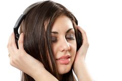 Brunette with headphones Stock Images