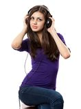 Brunette with headphones. Portrait of a brunette with headphones isolated on white Stock Photography