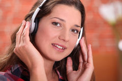 Brunette with headphones Royalty Free Stock Photography