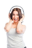 Brunette with headphones listening to music Royalty Free Stock Images