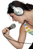 Brunette with Headphones and a Microphone (5) Royalty Free Stock Photos