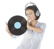 Brunette in headphones with vinyl record Stock Photo