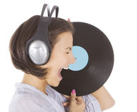Brunette in headphones with vinyl record ov Royalty Free Stock Images