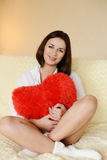 Brunette with heart Stock Images