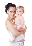 Brunette and her baby. Young mother with her baby on white background Royalty Free Stock Photos