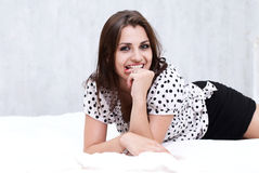 Brunette in her bed Royalty Free Stock Photo