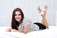 Brunette in her bed Royalty Free Stock Images