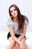 Brunette in her bedroom Royalty Free Stock Image
