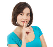 Brunette with her finger on her lips Stock Images
