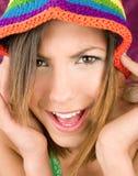 Brunette hermoso con el sombrero del color Imágenes de archivo libres de regalías