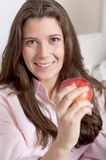 Brunette holding an apple Royalty Free Stock Photos