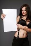 Brunette holding blank sign. Royalty Free Stock Image
